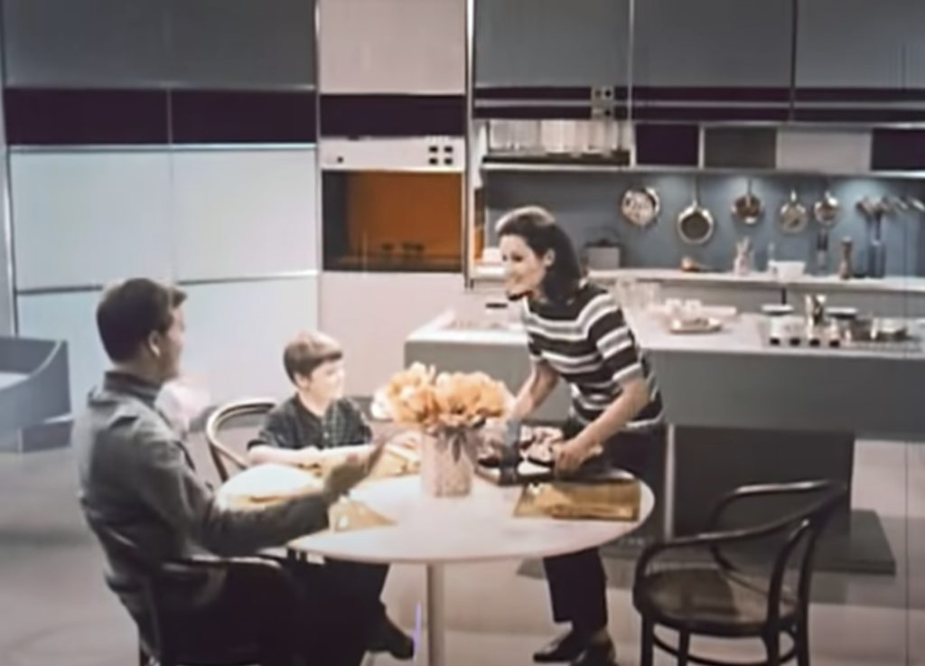Future Family eating dinner in 1999, as imagined in the 1960's.